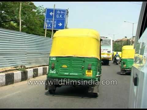 Driving in Delhi's yellow-green tuk-tuks or autos