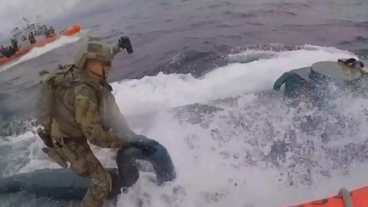 Officer Jumps on Submarine to Bust Alleged Drug Smugglers