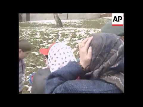 BOSNIA: TUZLA: YOUNG MUSLIM REFUGEE REUNITED WITH FAMILY