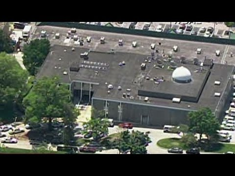 Car drives into Baltimore news station