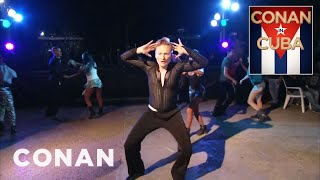 Conan Learns To Dance Cuban Rumba  - CONAN on TBS(Dancing is a huge part of Cuban culture, inspiring Conan to take an intensive lesson to master the erotic rumba. More CONAN @ http://teamcoco.com/video ..., 2015-03-05T18:09:41.000Z)
