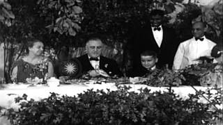 President Franklin Roosevelt and his wife at a thanksgiving dinner in United Stat...HD Stock Footage