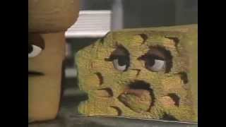 Classic Sesame Street Foods cooperate to make a sandwich