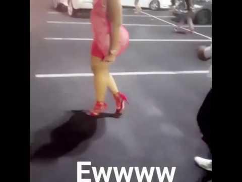 VIDEO.........WOMAN SHOWS HER BIG REAR BACK - Indecent dressing!