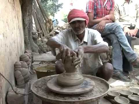 A Potter Kumhar Making a Pot Ghada with Clay Mud