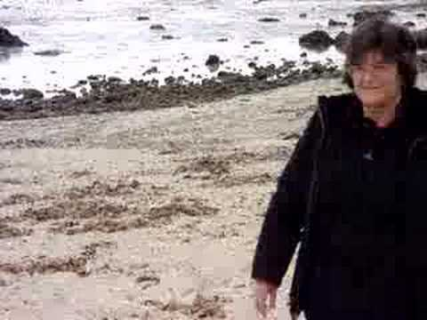 sharon hayes walks down beach