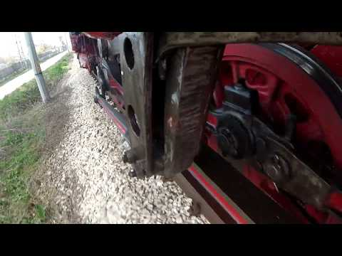 The driving gear of a moving steam locomotive