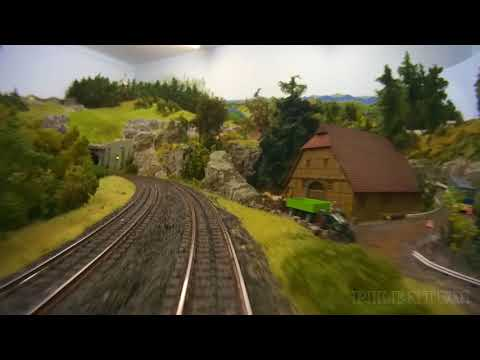Cab ride on a model railroad layout with hidden railway station in HO scale