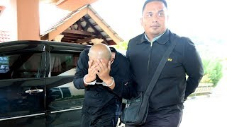Pembantu awam dituduh terima rasuah