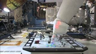 R2 Operating a taskboard on the ISS