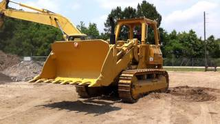 Caterpillar CAT 977L at Big Iron's Containerization Yard.MOV