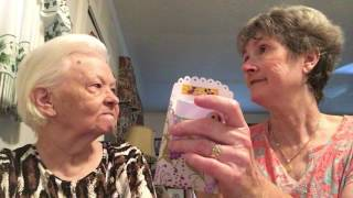 my mil mama lewis and i showing our first pocket letter that we have received