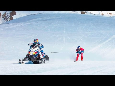 Towing a Skier Behind a Snowmobile at 90mph
