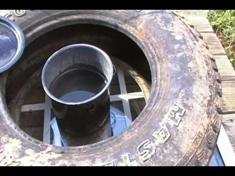 Improvised hot water heating devise from a tire and a piece of glass.