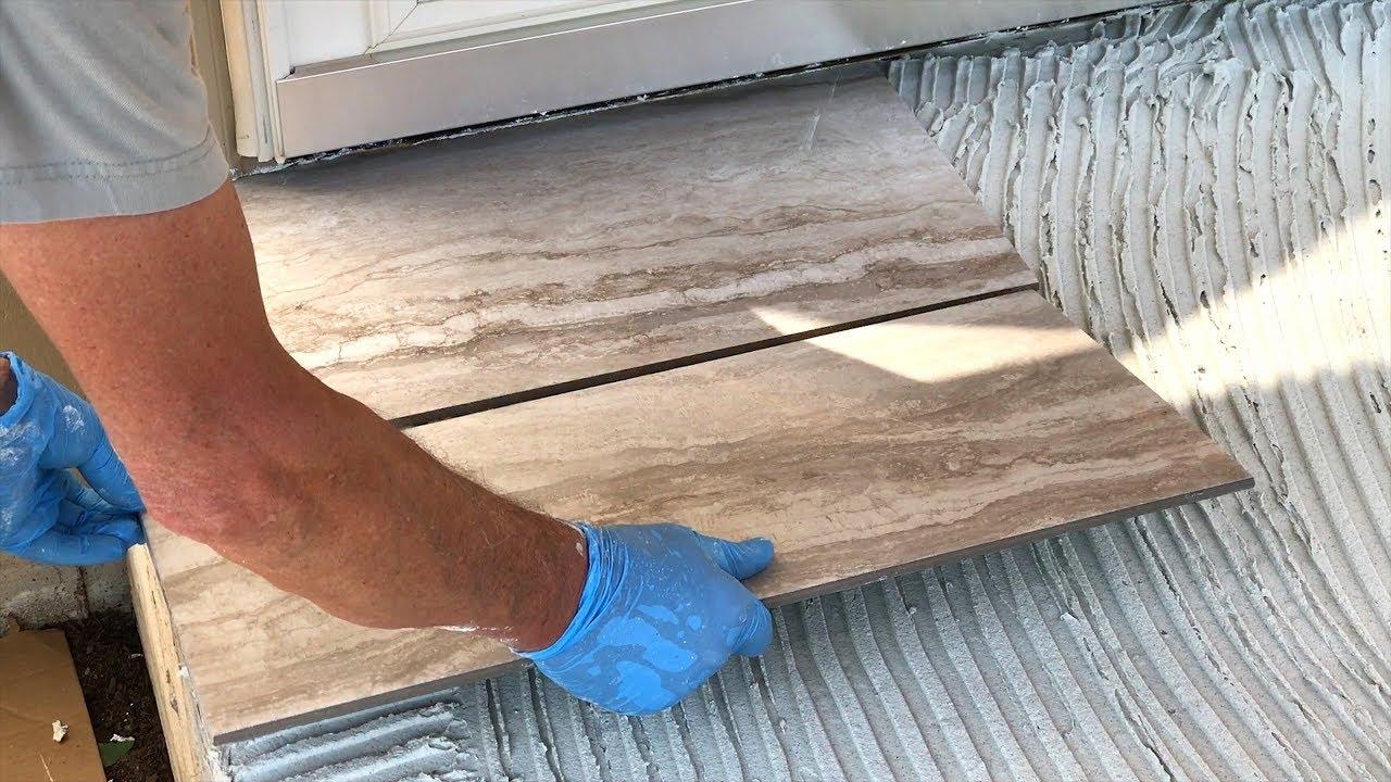 diy laying porcelain tile on a concrete porch