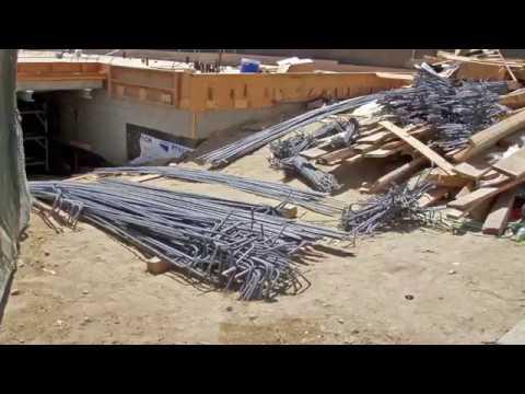 JMI Construction Apartment building subterranean underground parking garage