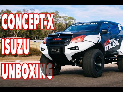 """UNBOXING The world's CRAZIEST Isuzu 2.4m/8 foot wide. 38"""" tires, long travel suspension. First Look!"""