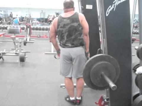 one arm smith machine shrugs