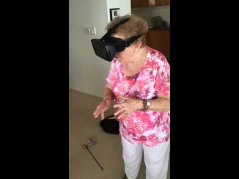 Grandma rides a virtual roller coaster for the first time