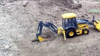 Motion stop ERTL John Deere backhoe in action.