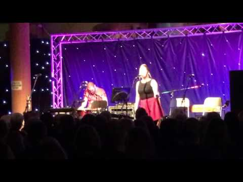 Sarah Ribbands and Jonny Miller performing 'Rather Be' live on stage
