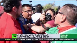 Clashes in Mexico as migrant caravan stalls at US border
