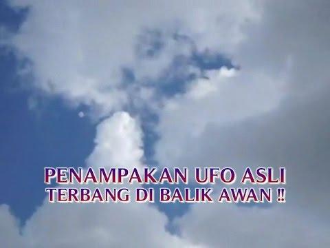 """VIDEO PENAMPAKAN UFO ASLI """"TERBANG DI BALIK AWAN ..."""