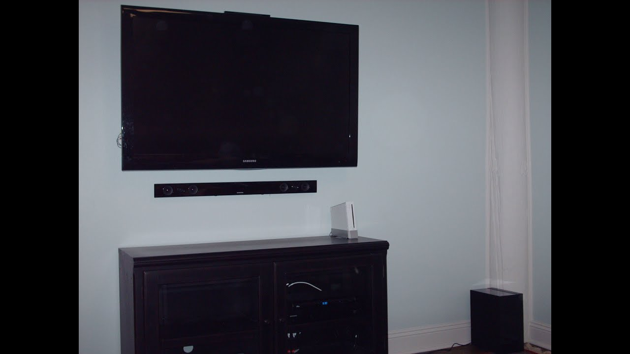how to conceal wires behind flat panel hd tv youtube. Black Bedroom Furniture Sets. Home Design Ideas