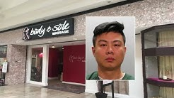 Massage parlor employee behind bars