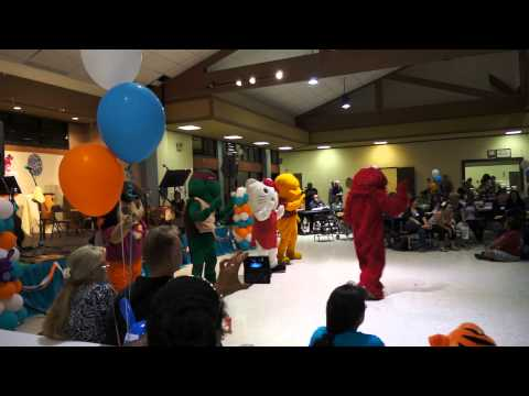Cartoon characters entertaining the children at our Easter Lu'au