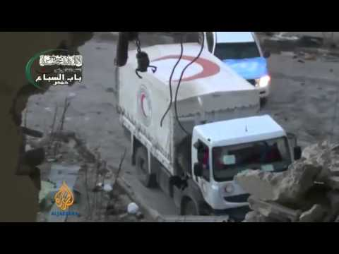 Aid convoy comes under attack in Homs