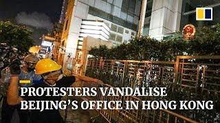 Protesters vandalise Beijing's office in Hong Kong
