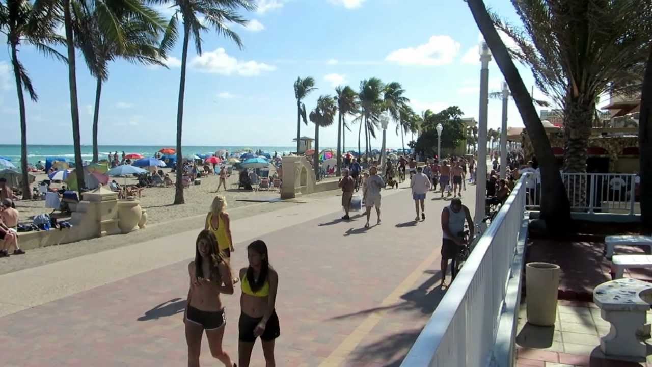 People On Broadwalk Hollywood Beach Florida Water Palm Trees