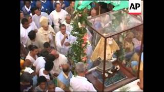 Procession through the streets in honour of Virgen de la Caridad