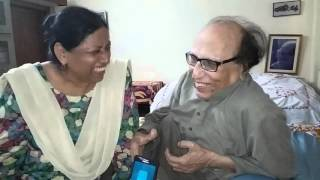 Dr. Bashir Badr being helped by his wife(Dr. Rahat Badr) recite some of his famous couplets...