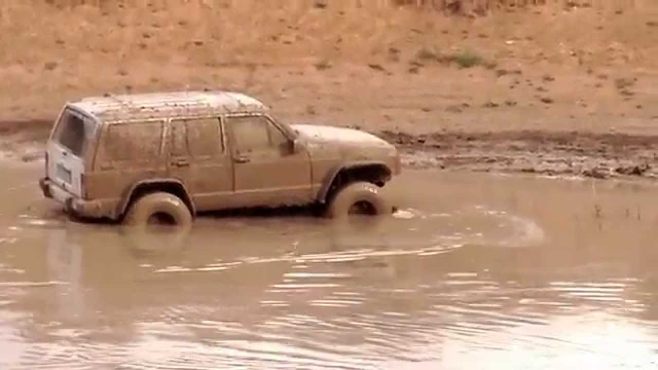 89 jeep cherokee mudding part 2 - youtube