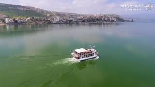 סירה בכנרת -טבריה ברקע .צילום אוויר יובל גסר 050-5909555