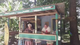 Iko iko - Ken and Sharon Litwak hanging out at back yard tiki bar having fun and singing.