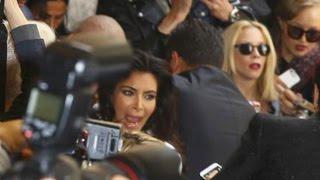 kim kardashian attacked at paris fashion week by a crazy fan watch the video