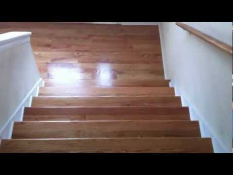 What does an unfinished hardwood floor looks like after refinishing