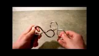 Figure 8 (The Sting) Metal Ring Puzzle SOLUTION(, 2013-04-16T00:13:59.000Z)