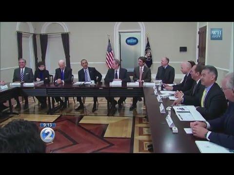 Obama heckles Ige about cold