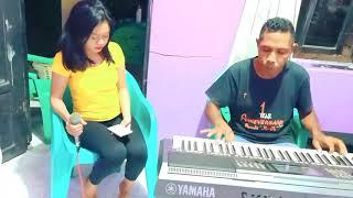 Di sini di batas kota ini. Live Keyboard Dina. Cipt. Zahir C Lubis