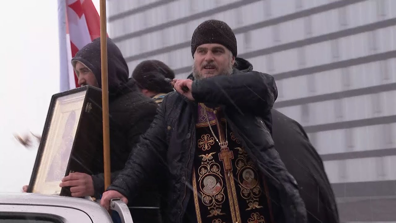 Orthodox Priests Bless Tbilisi Streets In Bid To Halt Disease