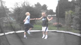 dakoma and logan on the trampoline