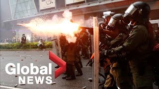 Hong Kong police fire water cannons, tear gas as protesters take to the streets