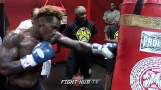 JERMALL CHARLO WRECKS HEAVY BAG WITH POWER PUNCH COMBINATIONS TO THE BODY DURING WORKOUT