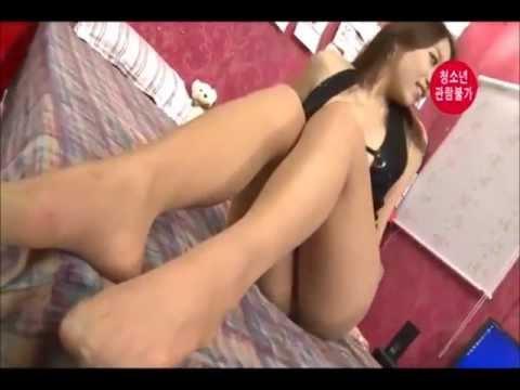 Korean Girl Putting on Stockings