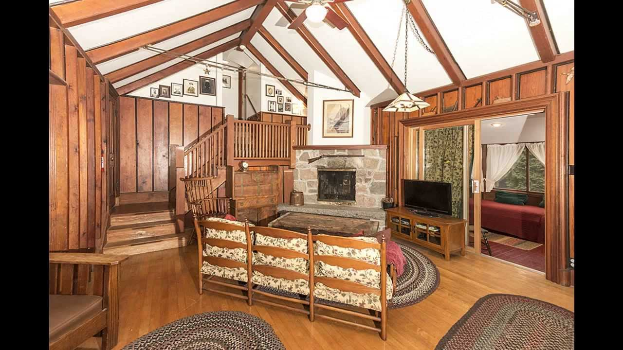 Living Room With Cathedral Ceiling And Fireplace