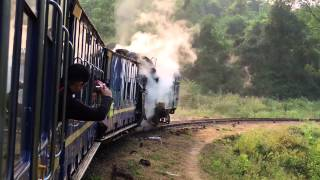 Nilgiri Mountain Railway: Steam loco working hard in the hills